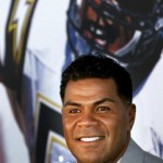 Junior Seau Shooting Football