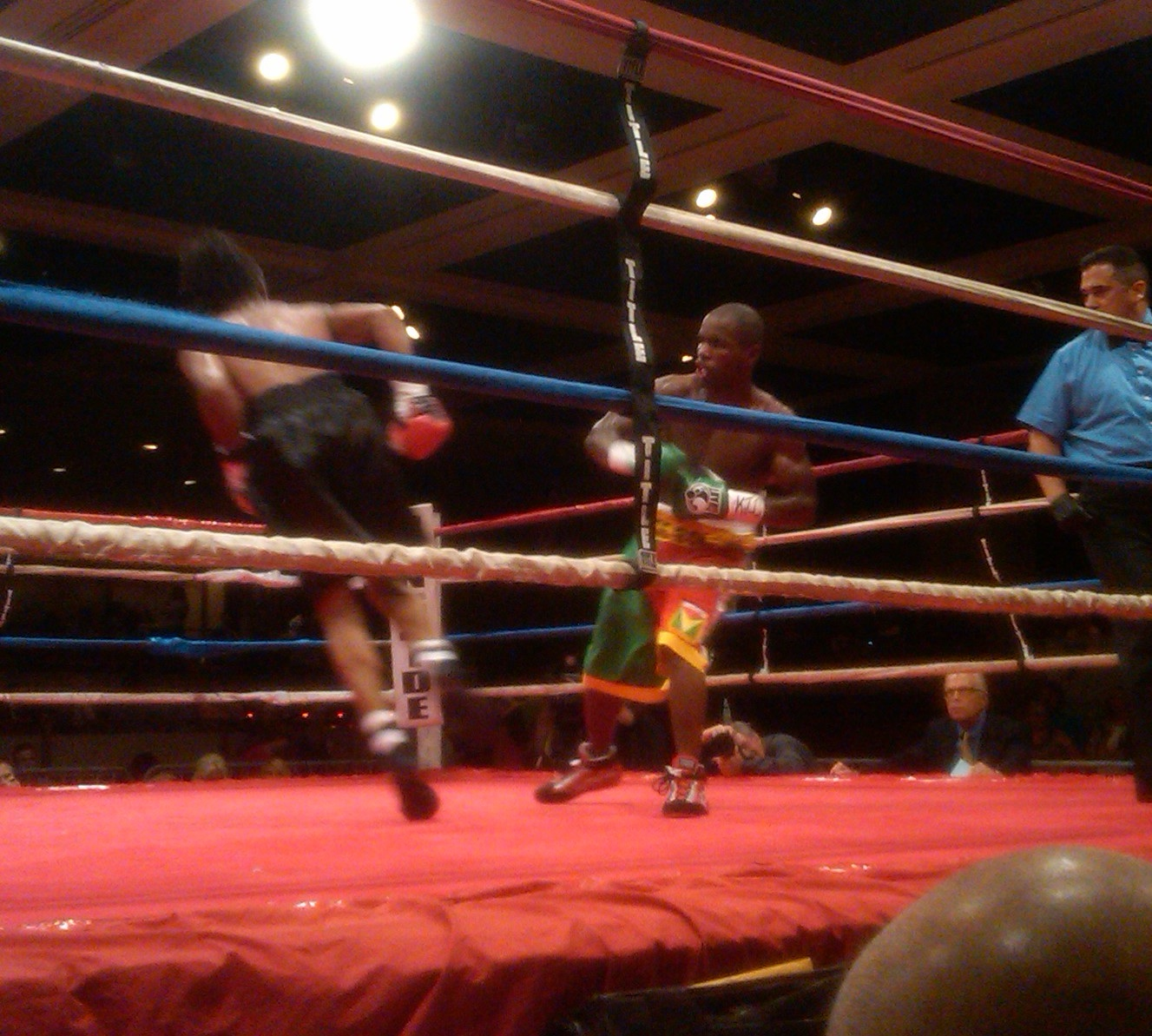 Omar Artis reels from a right hook from Schenectady, NY's Markus Williams during the main event of ARES Promotion's Fight Night IX at The Egg Convention Center.